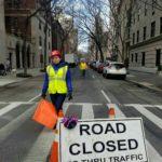 Woman Flagger in Street