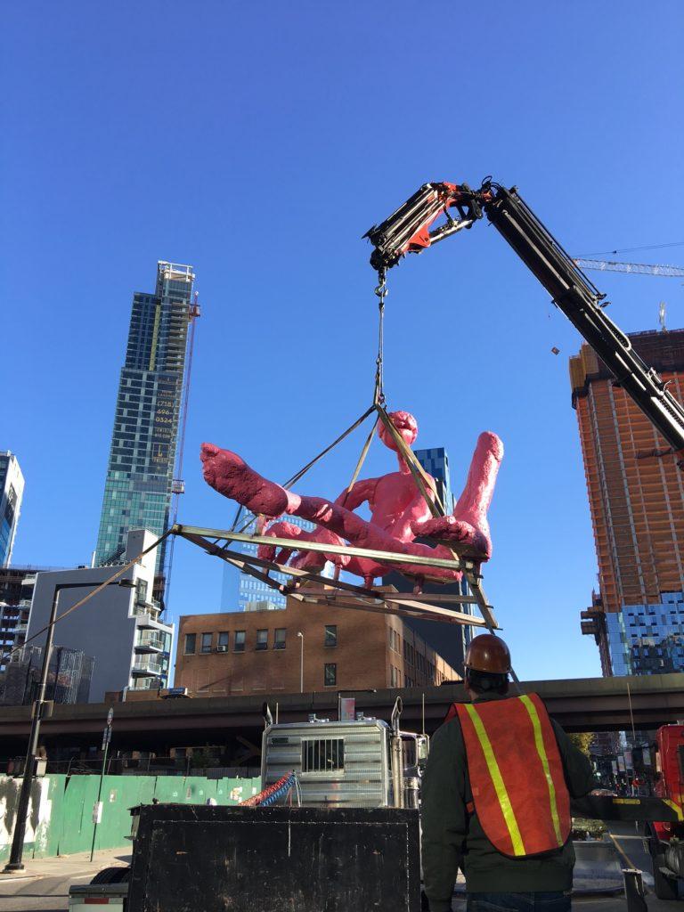 Crane Lifting Statue